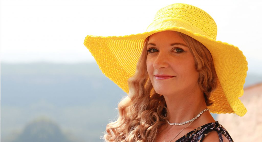 About Rebeccas | Ladies yellow wide brimmed sun hat with blonde hair