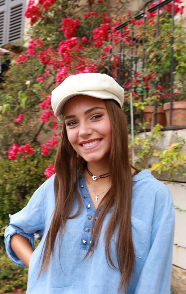 White Baker Cap with long brown hair